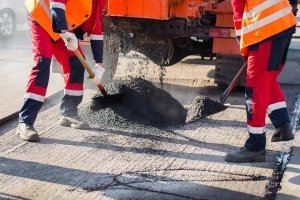Contractors performing asphalt overlay